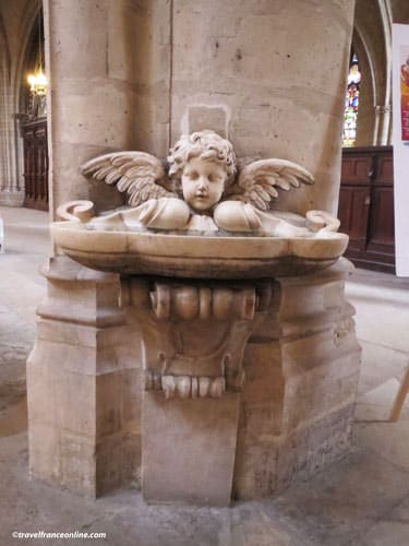 Saint Germain l'Auxerrois Church - 17th century font with angel