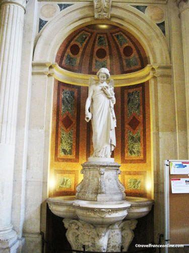 La Trinite Church - Font with angel