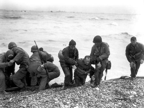 Omaha Beach - Helping comrades whose landing craft sunk