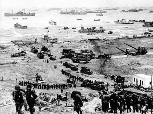 Omaha Beach - Reinforcements of men and equipment moving inland