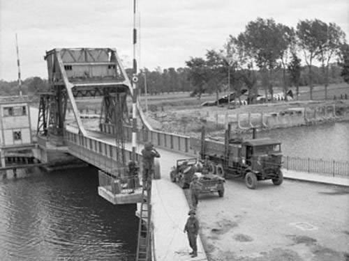 Transport moving across Pegasus Bridge in 1944