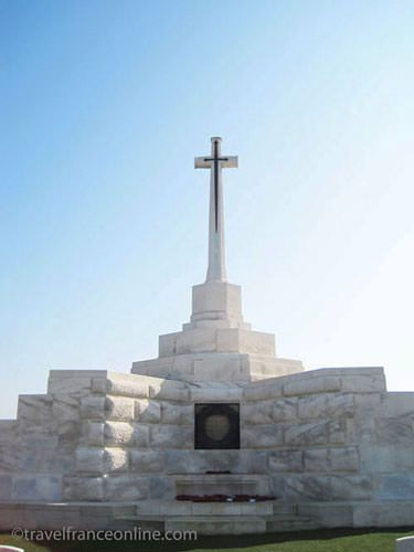 Tyne Cot Cemetery on Passchendaele Ridge - Cross of Sacrifice with German pillbox seen through glass opening