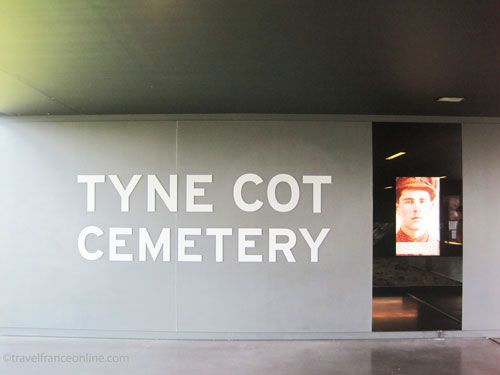 Tyne Cot Cemetery on Passchendaele Ridge - Interpretative Centre: screen with the photo of one of the soldiers buried in Tyne Cot Cemetery