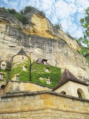 Manor-house built against the rock face in La Roque Gageac