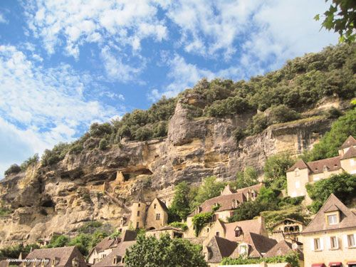 Vestiges of La Roque Gageac fortress can still be seen in the cliff face