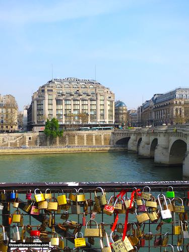 Love locks on Pont-Neuf with Samaritaine in the background