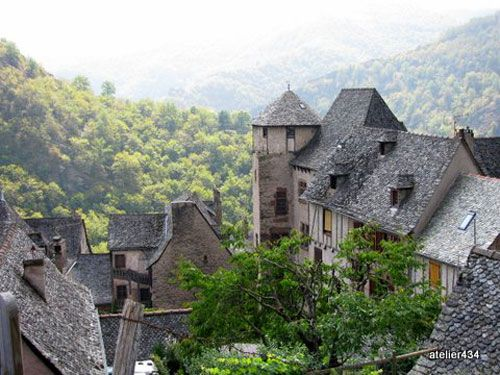 Village of Conques on a misty morning