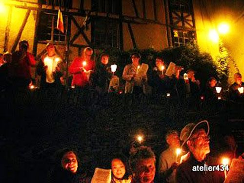 The candlelit crowd on Sainte Foy Feast Day in Conques