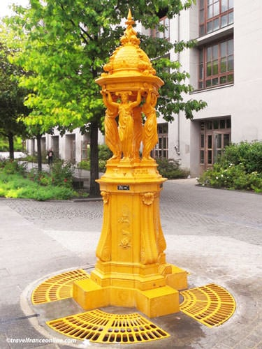 Wallace Fountains - Traditional fountain painted yellow on Place Verlaine