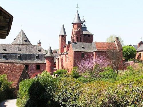 Church and Castel de Vassinhac in Collonges-la-Rouge