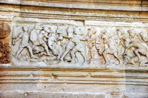 Saint-Pierre of Assier Church - Frieze depicting a battle
