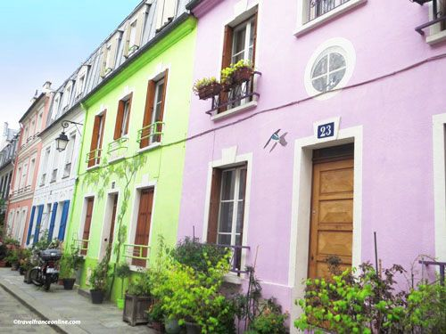 Colorful houses in Rue Cremieux - A bird at no23 and a wisteria at no21