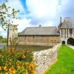 Chateau de Gratot - Tour Ouest, commons and entrance gatehouse overlooking the moats