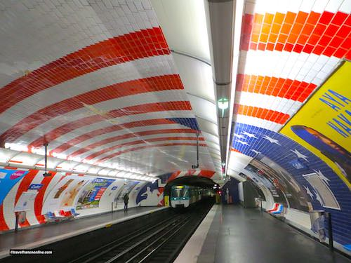 Cadet Metro station - American flag on the vaulted ceiling and Lafayette by the tunnel