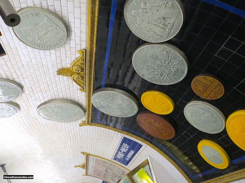 Oversized reproductions of coins in Pont-Neuf Metro station