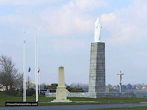 Notre-Dame-des-Flots and the Royal Engineers Monument overlooking Gold Beach and Arromanches - Gold Beach War Memorials