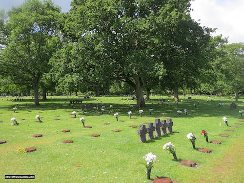 La Cambe German war cemetery - Graves and granite crosses under the oak trees